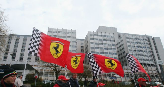 Ferrari fans gather outside the hospital