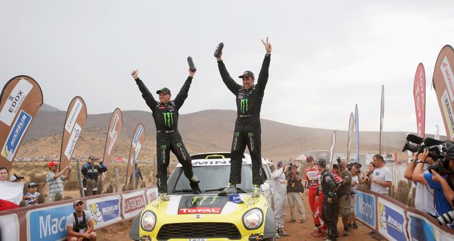 Nani Roma (R) and co-driver Michel Perin celebrate victory in the Dakar Rally