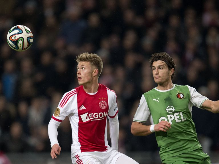 Ajax's Viktor Fischer (left) in action