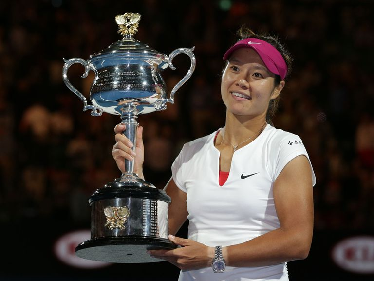 China's Li Na holds the trophy aloft