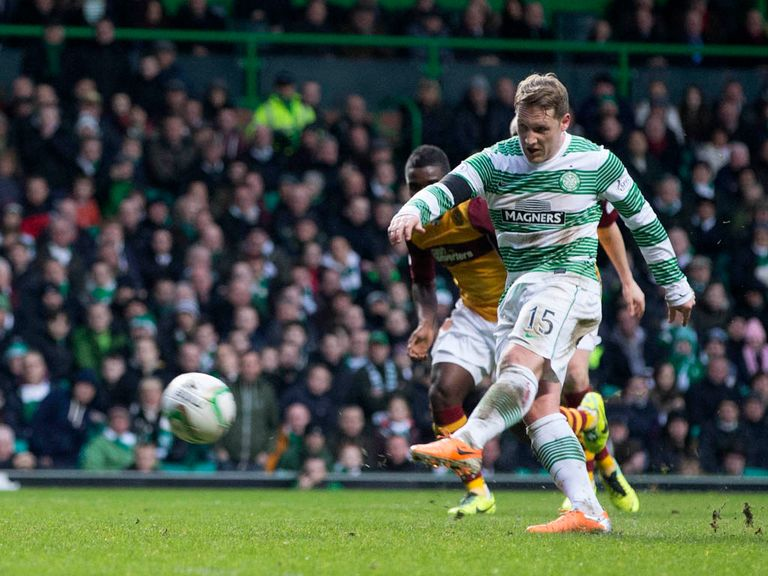 Kris Commons scores from the penalty spot as Celtic beat Motherwell.