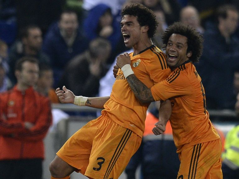Real Madrid goalscorer Pepe celebrates with Marcelo