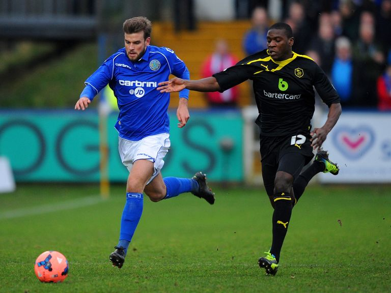 Macclesfield Town's Jeremy Helan in FA Cup action