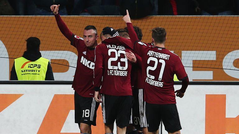 Josip Drmic of Nuernberg celebrates with team mates