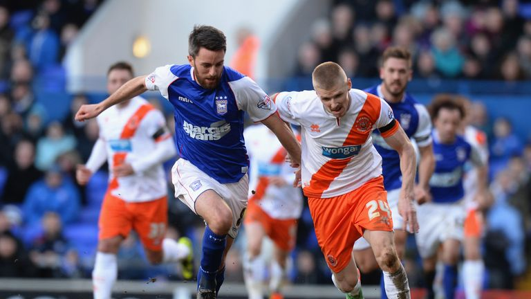 Cole Skuse of Ipswich Town tackles Andy Keogh of Blackpool.