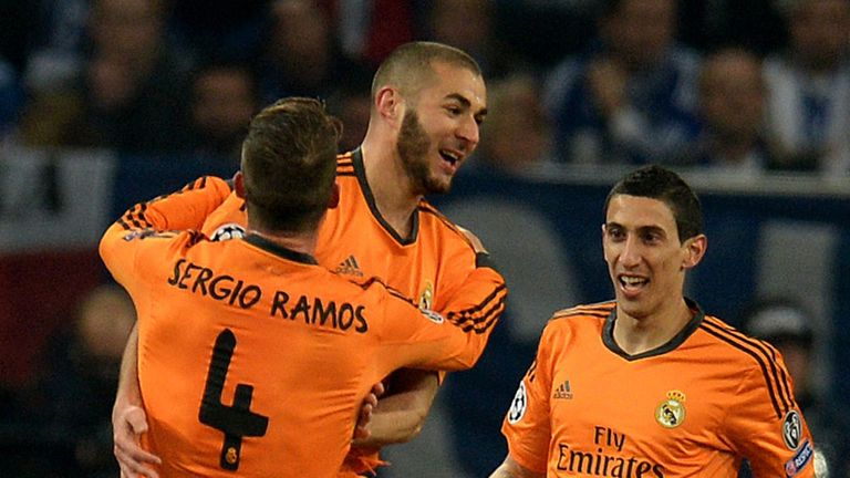 Karim Benzema is mobbed by his team-mates after scoring in the demolition of Schalke
