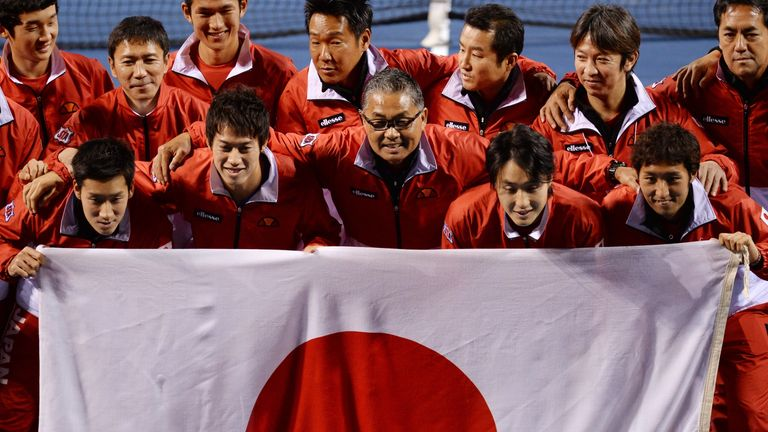 Japan celebrate after securing a 4-1 victory over Canada in Tokyo
