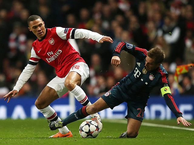 Kieran Gibbs and Philipp Lahm tangle