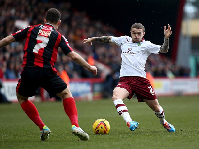Kieran Trippier of Burnley looks to get past Marc Pugh
