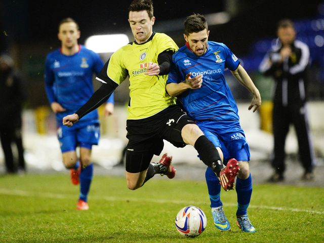 Stranraer's Grant Gallacher (left) battles with Graeme Shinnie
