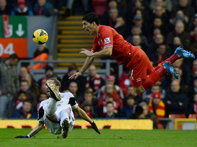 Luis Suarez takes a tumble