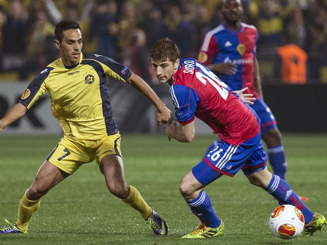 Basel defender Gaston Sauro is challenged by Eran Zahavi
