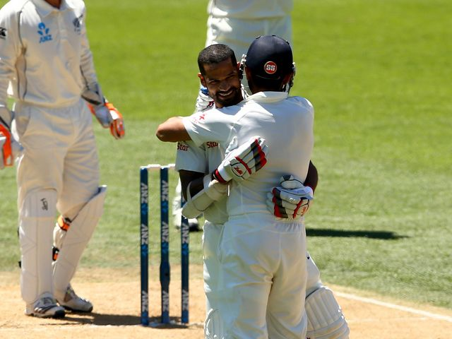 Shikhar Dhawan celebrates his century against New Zealand
