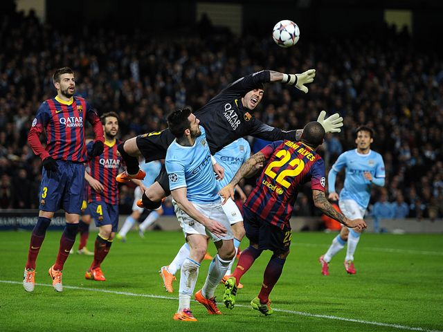 Barcelona goalkeeper Victor Valdes reaches for the ball