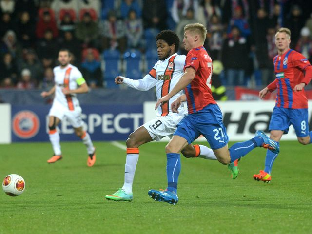Vaclav Prochazka of Plzen vies for a ball with Luiz Adriano Shakhtar