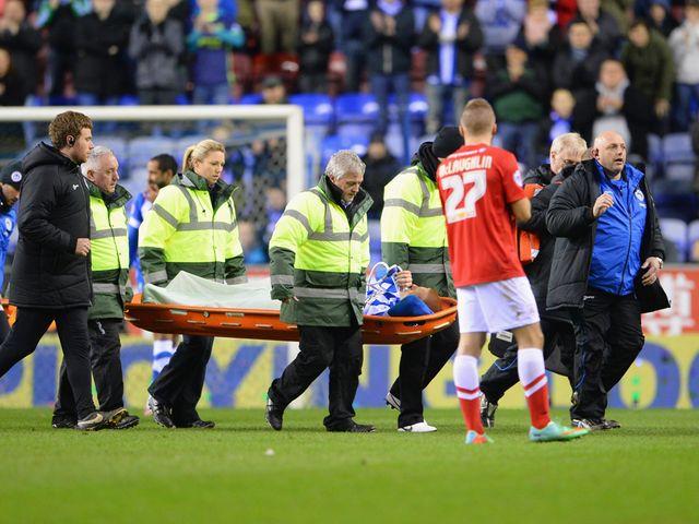 Ben Watson of Wigan is taken off injured