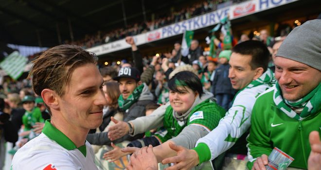 Goalscorer Ludovic Obraniak celebrates with Werder Bremen fans