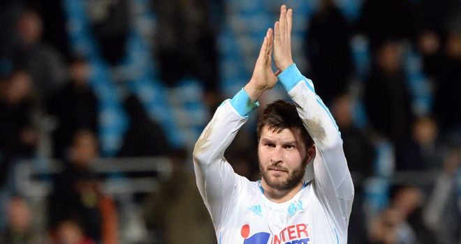 Goalscorer Gignac celebrates at the final whistle
