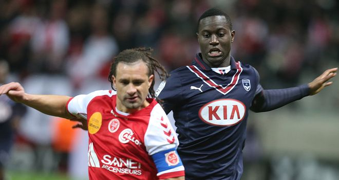 Reims' Mickael Tacalfred (left) vies with Bordeaux's Henri Saivet