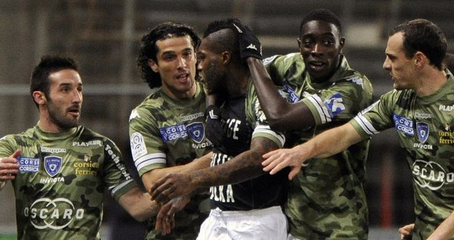 Djibril Cisse celebrates the opening goal