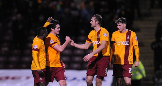 Carl McHugh: Celebrates Bradford's winner