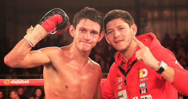Gavin McDonnell celebrates British title win with twin brother Jamie (Pic Lawrence Lustig)