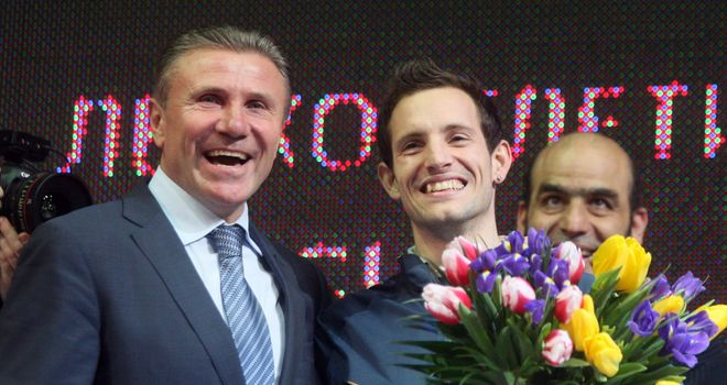 Sergey Bubka (left) congratulates Renaud Lavillenie on breaking his indoor pole vault world record