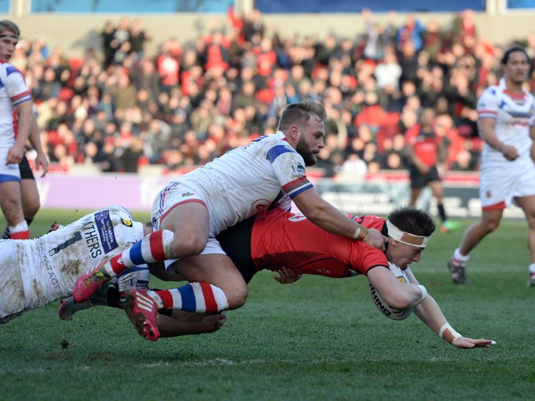 Andrew Dixon scores a try in Salford's win over Wakefield