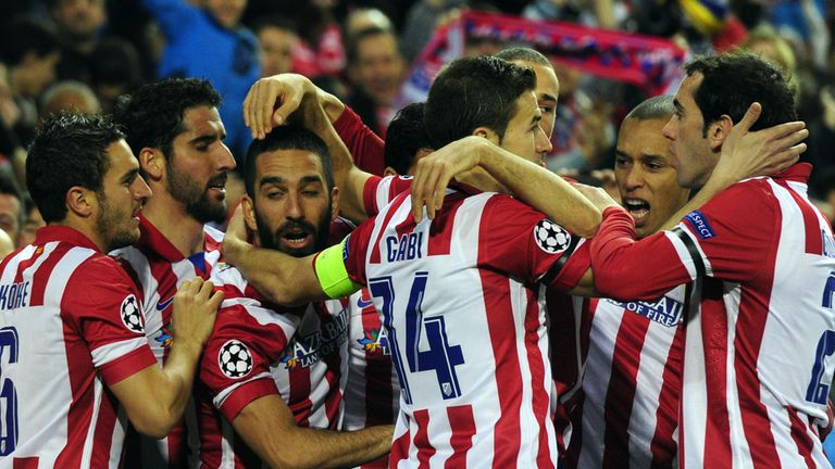 Atletico celebrate as they cruised past AC Milan with a convincing win