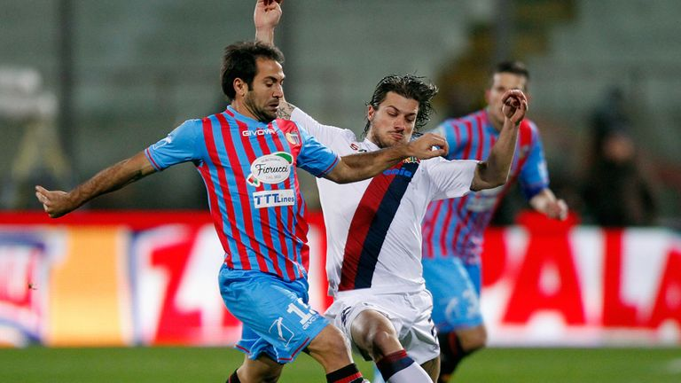 Fabian Rinaudo (left) of Catania battles with Daniele Dessena
