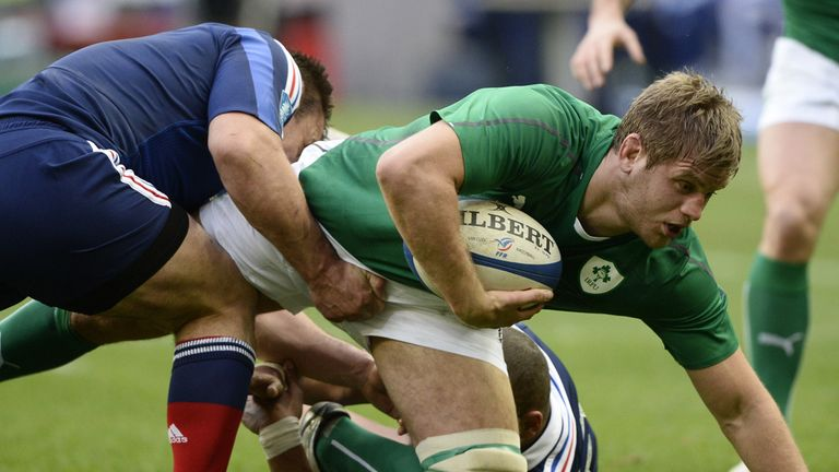 Chris Henry of Ireland lunges forward during the victory over France