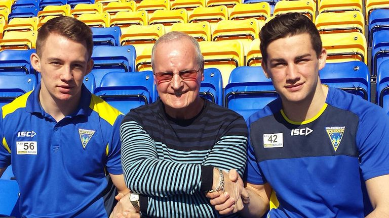 Club ambassador Alex Murphy (centre) welcomes George (left) and Toby (right) to the big time
