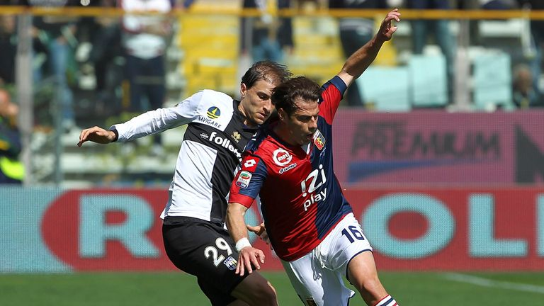 Emanuele Calaio is challenged by Gabriel Paletta