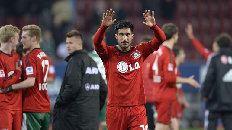 Leverkusen's midfielder Emre Can celebrates at full time