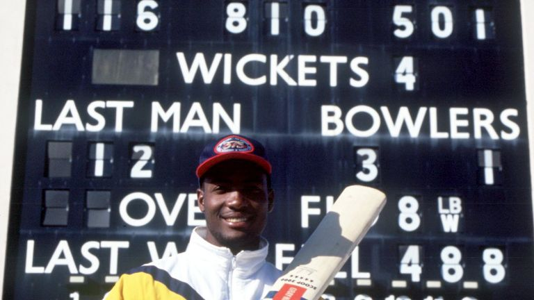 Brian Lara poses in front of the scoreboard at Edgbaston after scoring 501 for Warwickshire in 1994