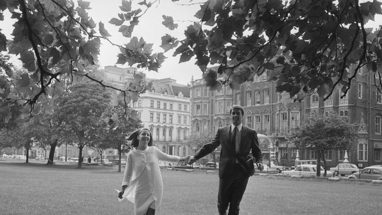 Geoff Hurst and his wife on their way to the Royal Garden Hotel in Kensington for a reception