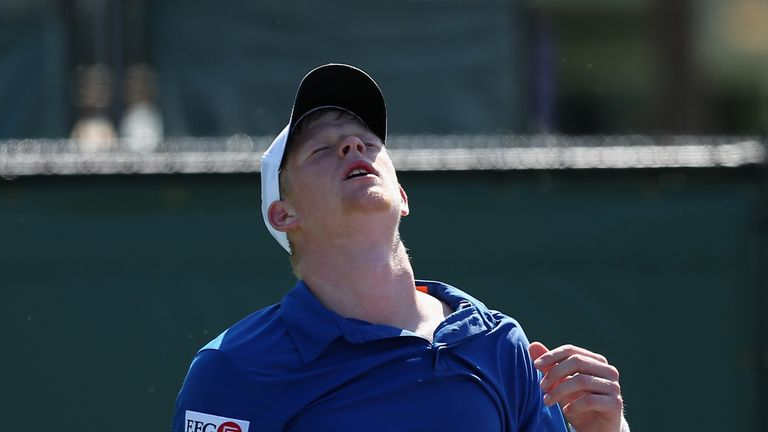 Kyle Edmund of Great Britain dejected after losing to to Julien Benneteau of France in Miami