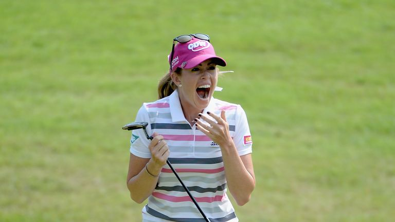 Paula Creamer celebrates after winning the HSBC Champions in a play-off against Azahara Munoz