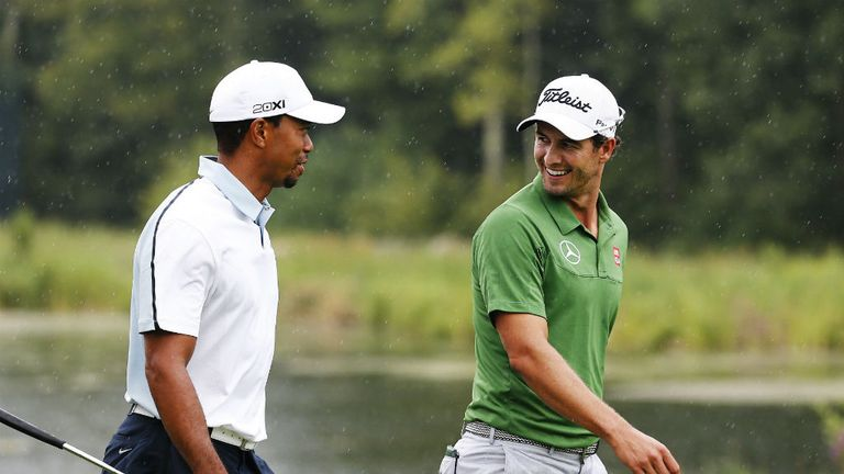Adam Scott (r) could replace Tiger Woods (l) as world No 1 this week