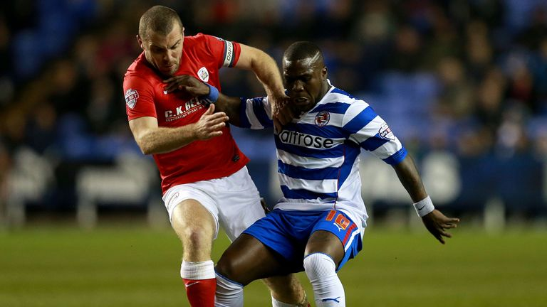 Goalscorer Dawson in action against Reading's Royston Drenthe