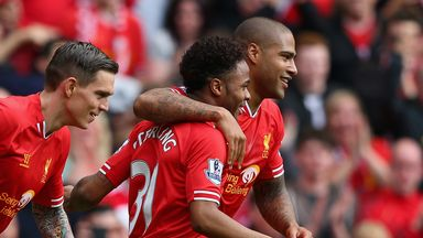 Glen Johnson celebrates with Raheem Sterling during Sunday's 4-0 rout at Anfield
