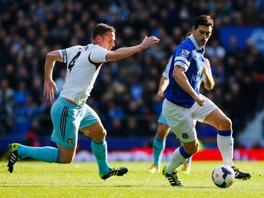 Gareth Barry is closed down by Kevin Nolan