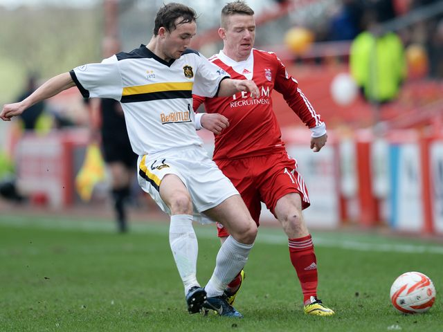 Dumbarton's Chris Kane and Jonny Hayes go for the ball