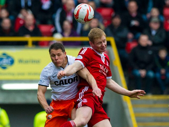 John Rankin contests an aerial ball with Barry Robson