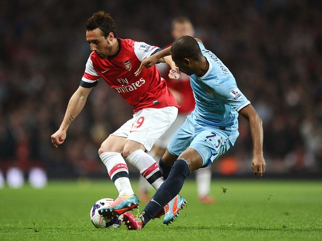 Santi Cazorla and Fernandinho battle for the ball