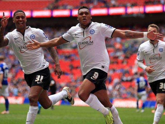 Peterborough United's Britt Assombalonga celebrates