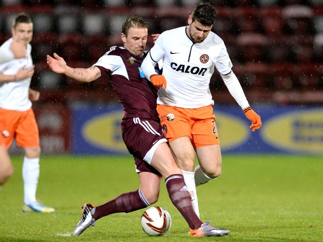 Ryan Stevenson makes a challenge on Nadir Ciftci