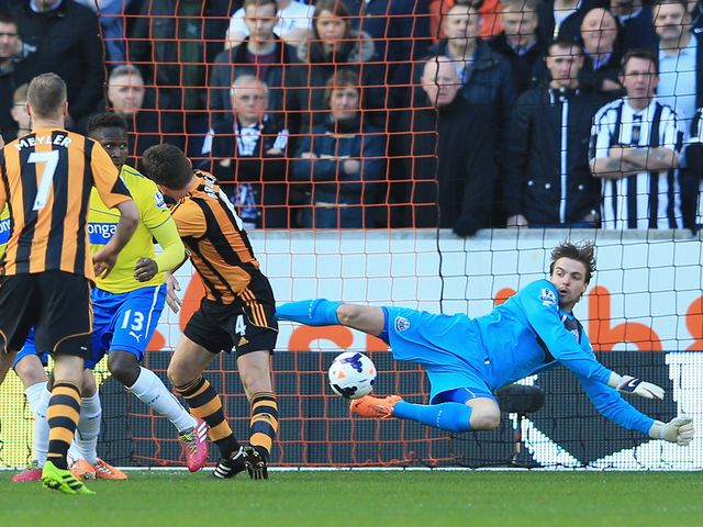 Tim Krul makes a save from Alex Bruce