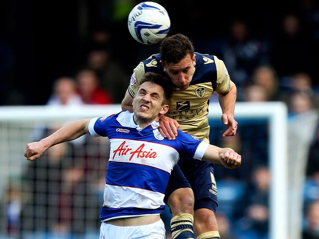Jason Pearce towers above Kevin Doyle to win a header