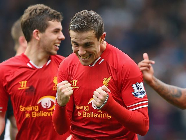 Jordan Henderson celebrates after scoring Liverpool's fourth
